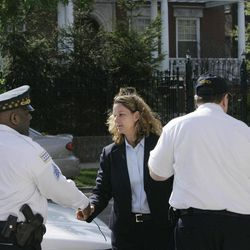 FILE - In this Thursday, May 3, 2007 file photo, a female Secret Service agent introduces herself to Chicago Police outside the home of Democratic Sen. Barack Obama, in Chicago's Hyde Park neighborhood. The Secret Service said Thursday that Obama was being placed under its protection, the earliest ever for a presidential candidate. The Secret Service has been tarnished by a prostitution scandal that erupted April 13, 2012 in Colombia involving 12 Secret Service agents, officers and supervisors and 12 more enlisted military personnel ahead of President Barack Obama's visit there for the Summit of the Americas.