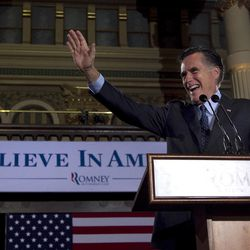 Republican presidential candidate, former Massachusetts Gov. Mitt Romney greets the crowd at a primary election night rally in Milwaukee, Tuesday, April 3, 2012, after Romney won the Wisconsin Republican presidential primary.