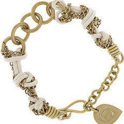 "<a href=""http://www.theoutnet.com/product/273558""><b>MADE</b> Kumukoye brass and cord bracelet</a>, $30"
