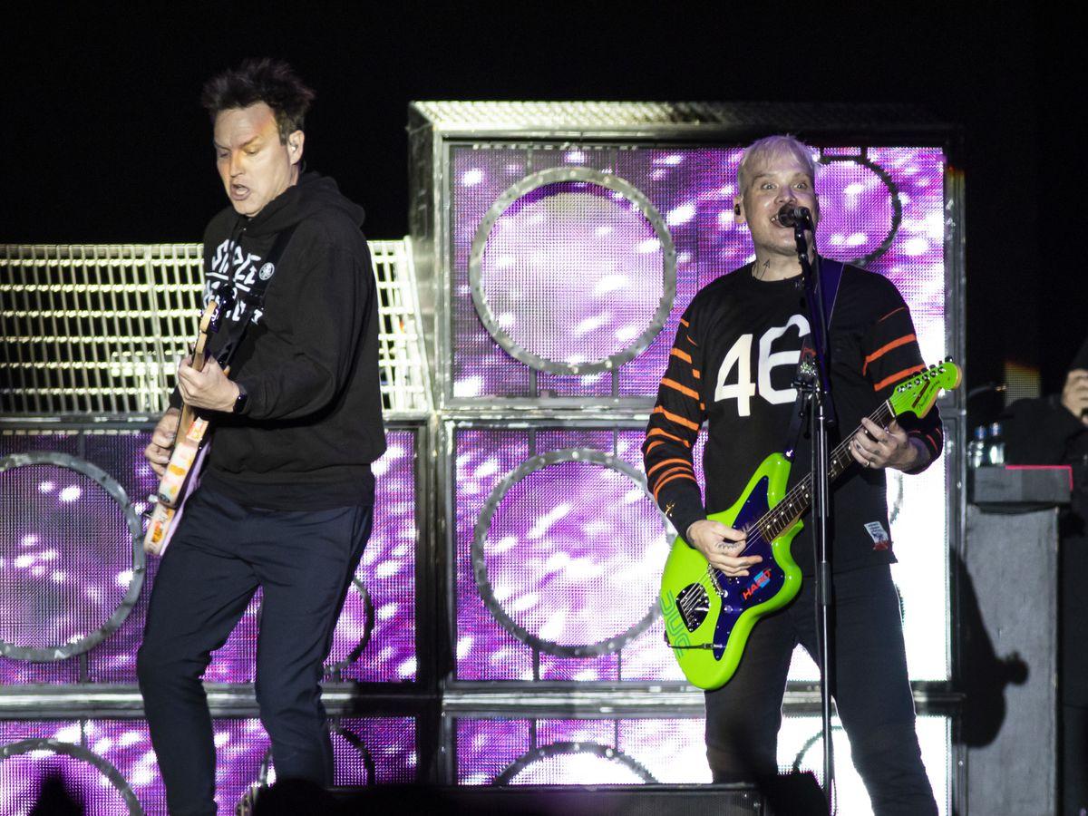 Mark Hoppus and Matt Skiba, of Blink 182, perform on day one of Riot Fest in Douglas Park, Friday night, Sept. 13, 2019.