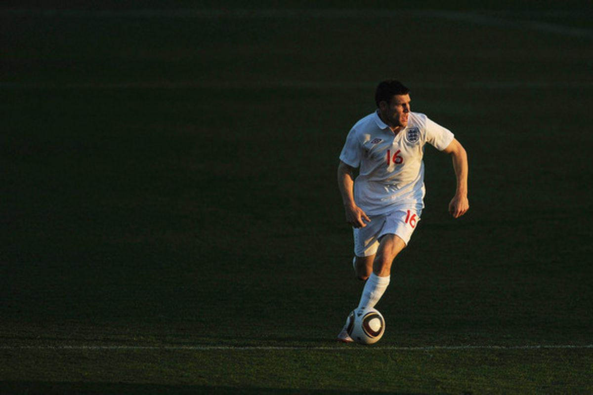MORULENG, SOUTH AFRICA - JUNE 07: James Milner of England runs on the ball during the friendly match between England and Platinum Stars at the Moruleng Stadium on June 7, 2010 in Moruleng, South Africa.  (Photo by Michael Regan/Getty Images)