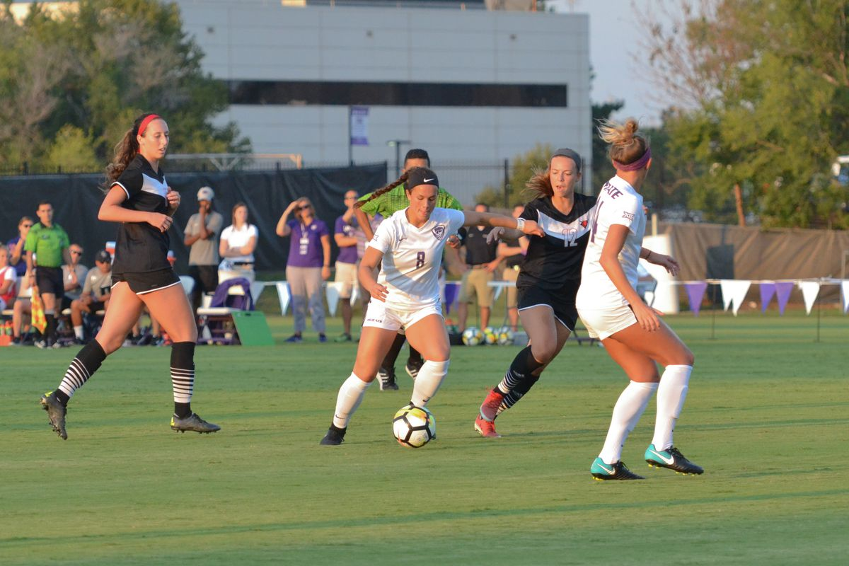 Kansas State midfielder Brookelynn Entz (8) dribbles upfield while forward Tatum Wagner (44) looks on during K-State's 2-0 victory over Omaha on August 30, 2017.