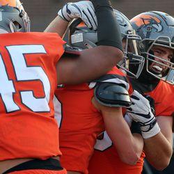 Skyridge players celebrate Jace Doman's interception and touchdown during a high school football game against Orem at Skyridge High School in Lehi on Friday, Sept. 3, 2021. Skyridge won 36-0.