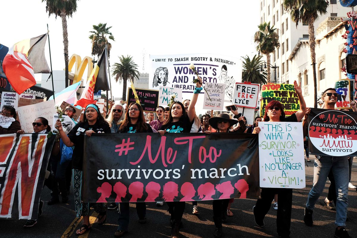 """Activists hold a banner that reads """"#MeToo survivors' march"""" in the 2018 #MeToo March."""