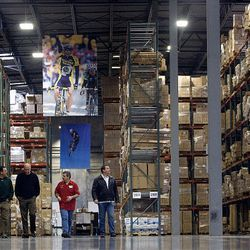 Dan deTorbal, Robert McOmber, warehouse manager Rick Petersen and Mike Riddle tour the distribution center in Salt Lake City. The Specialized warehouse will serve the western U.S.