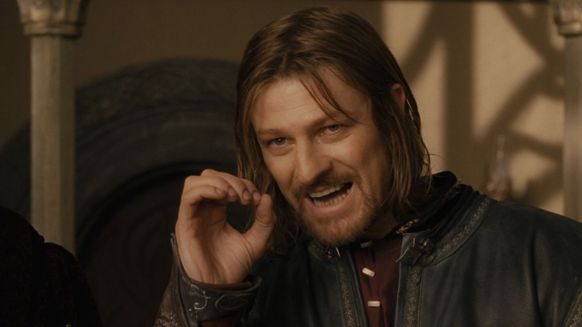Boromir curls his hand into a circle as he speaks during the Council of Elrond in The Fellowship of the Ring.