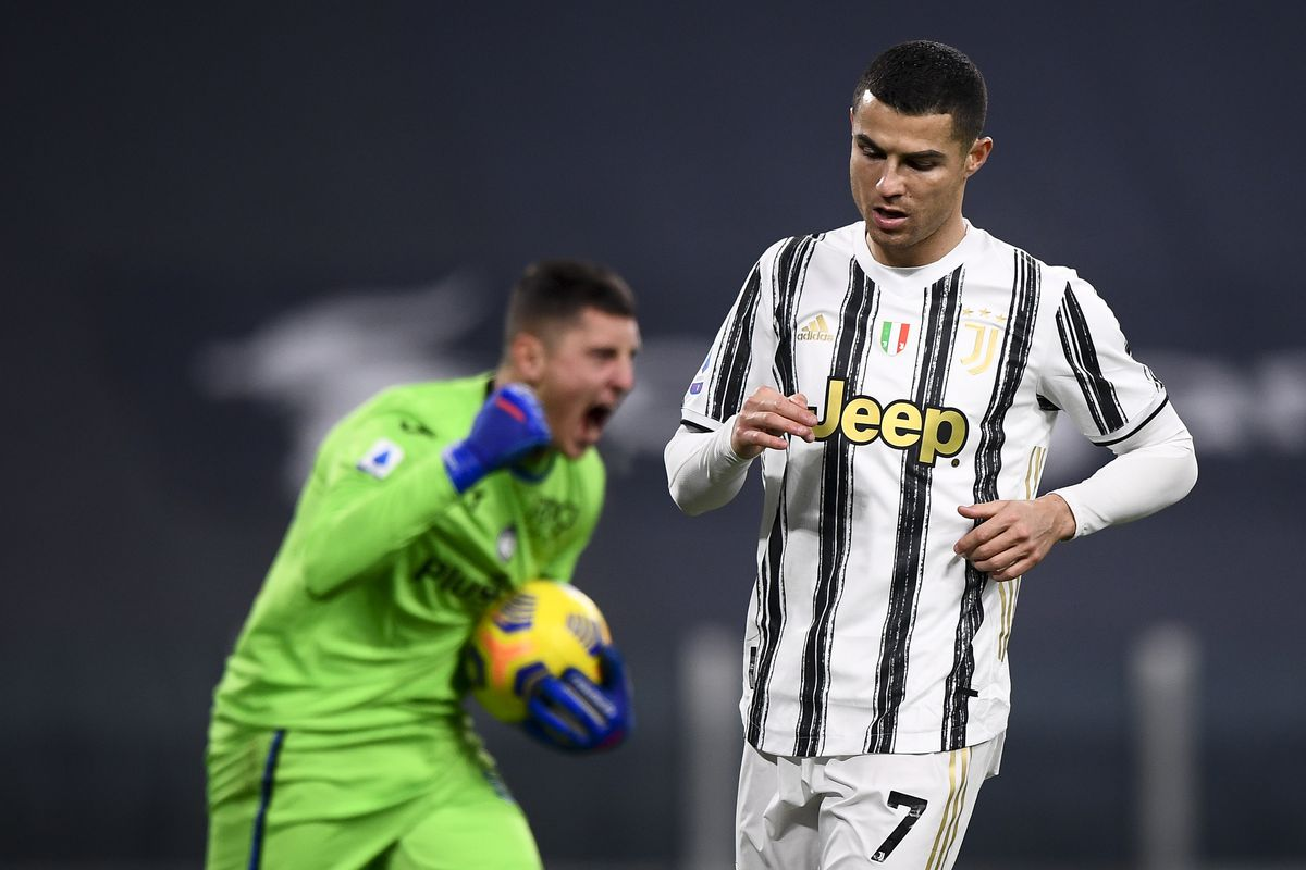 Cristiano Ronaldo (R) of Juventus FC looks dejected after...