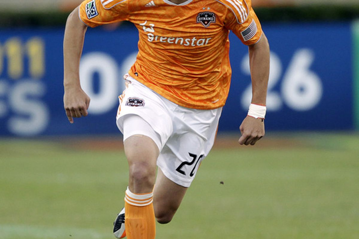 HOUSTON - OCTOBER 23:  Geoff Cameron #20 of the Houston Dynamo rushes the ball up the field against the Los Angeles Galaxy at Robertson Stadium on October 23, 2011 in Houston, Texas.  (Photo by Bob Levey/Getty Images)