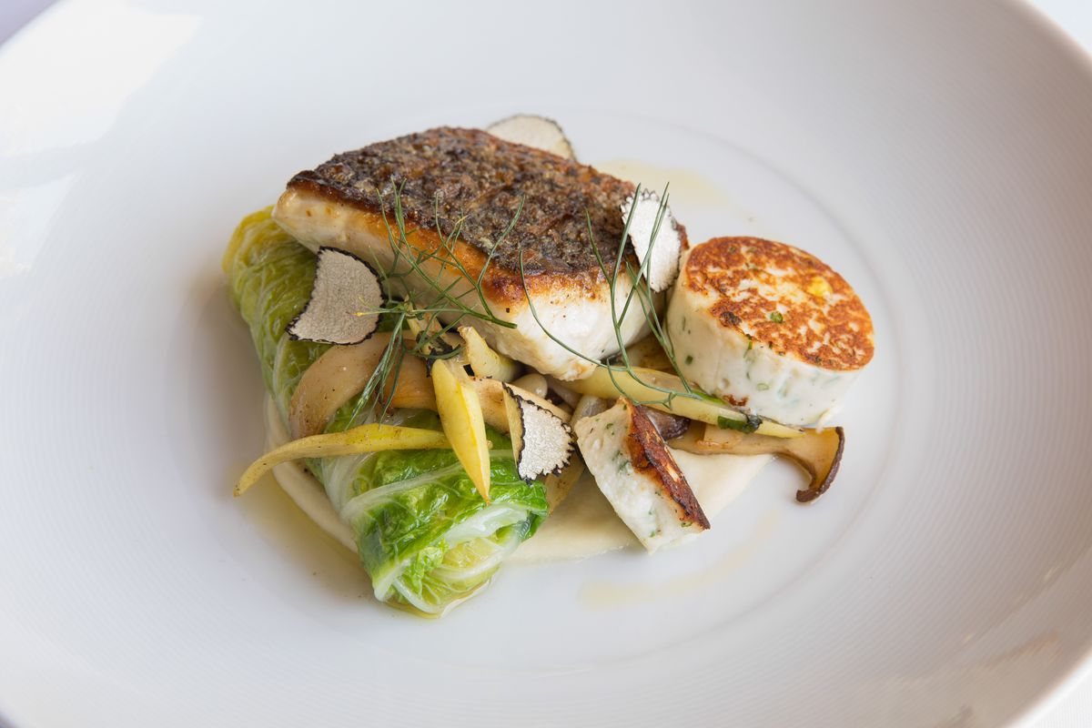 Striped bass with beans, cabbage, and truffle at Mooncusser Fish House