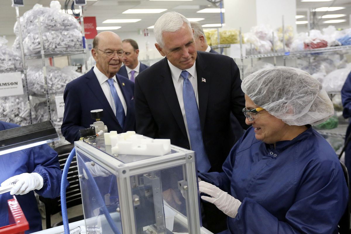Vice President Mike Pence, center, talks with Orfelina Perez, a production operator at Merit Medical, while touring a clean room with Secretary of Commerce Wilbur Ross, left, in the Rex and Anita Bean Building at the Merit Medical headquarters in South Jordan on Thursday, Aug. 22, 2019.