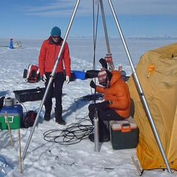 Several Utah scientists flew to the Greenland ice sheet, which is 1,500 miles long and nearly 700 miles wide. The Utah team joined other scientists who lived in tents on the ice while conducting their studies. An apparatus is pulled up from a vertical hole the team bored into the ice sheet.