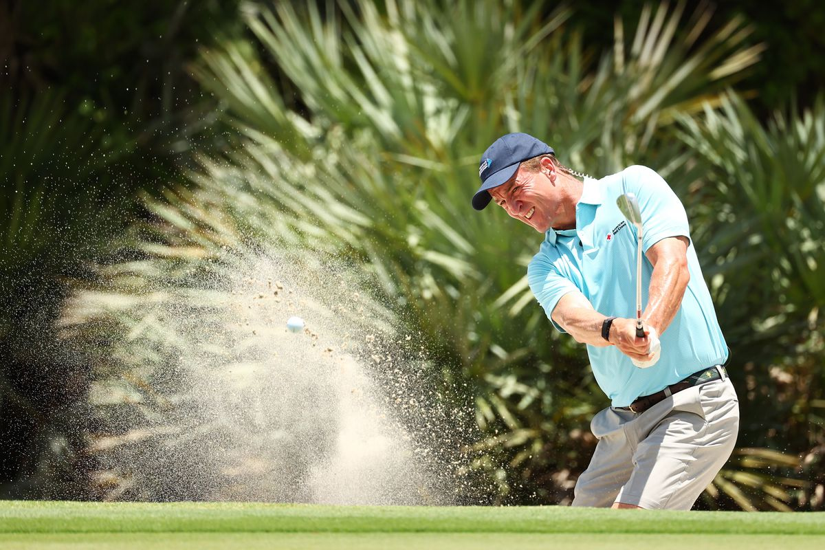 Former NFL player Peyton Manning plays a shot from a bunker during a practice round for The Match: Champions For Charity at Medalist Golf Club on May 23, 2020 in Hobe Sound, Florida.