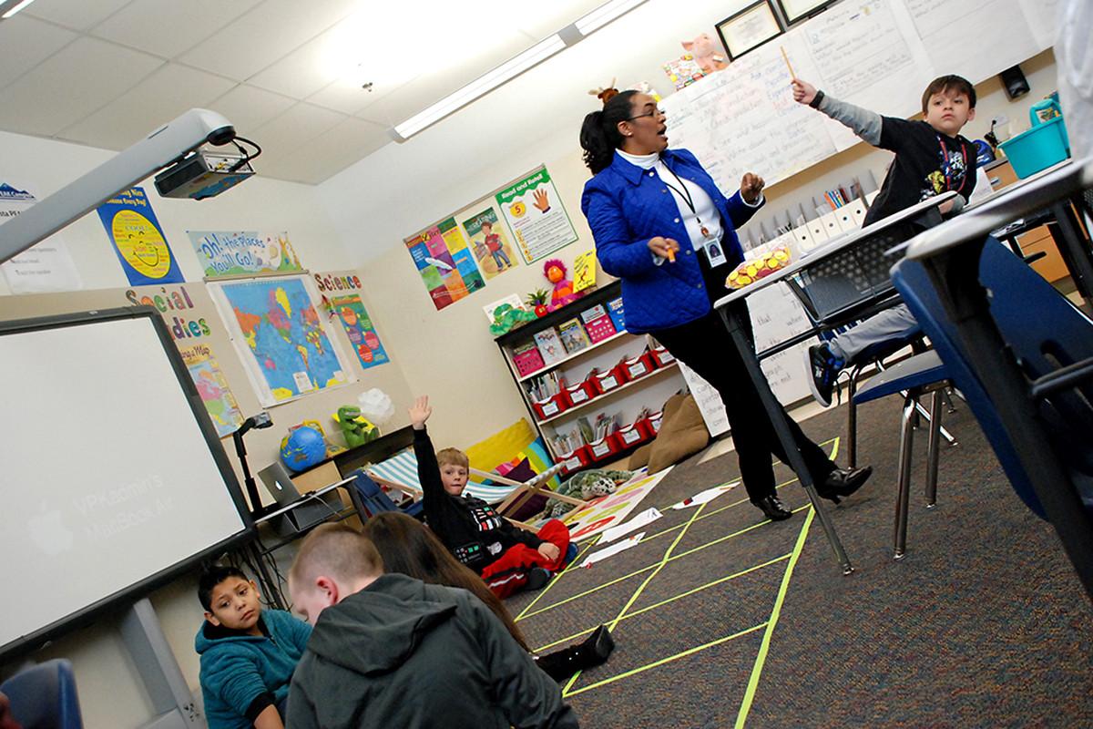 Aurora Public Schools teacher Shawn E. Bailey leads a classroom at Vista Peak Exploratory in 2014.
