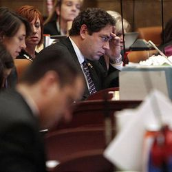Rep. Brian King listens to debate during the Legislature's final hours Thursday.