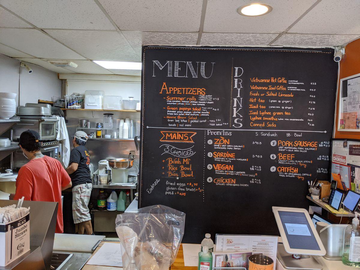 A restaurant interior with a chalkboard menu.