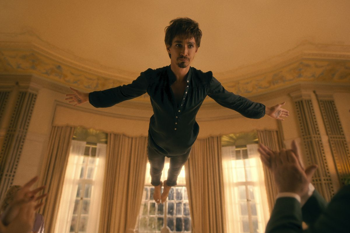 klaus suspended in air and pretending to fly