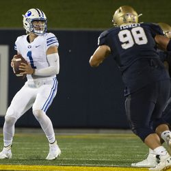 BYU quarterback Zach Wilson (1) looks to throw as Navy guard Mike Flowers (98) applies pressure during the first half of an NCAA college football game, Monday, Sept. 7, 2020, in Annapolis, Md.