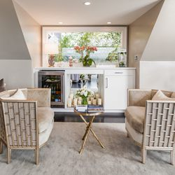 """A sitting area and wet bar in the penthouse retreat. [Photo by <a href=""""http://www.patriciachangphotography.com/"""">Patricia Chang</a>]"""