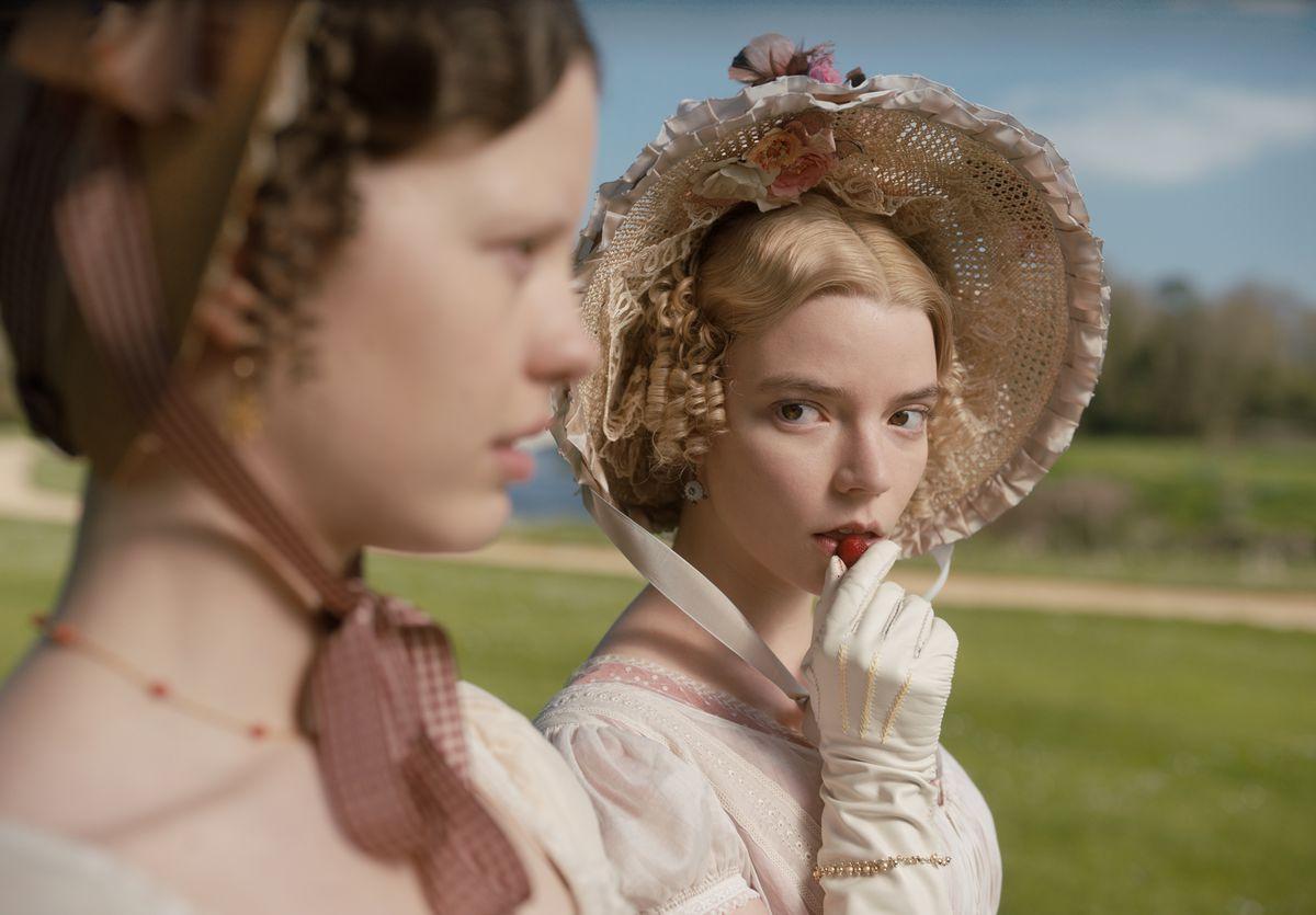 Emma giving a side eye toward Harriet as she slowly eats a strawberry in Emma. (2020)