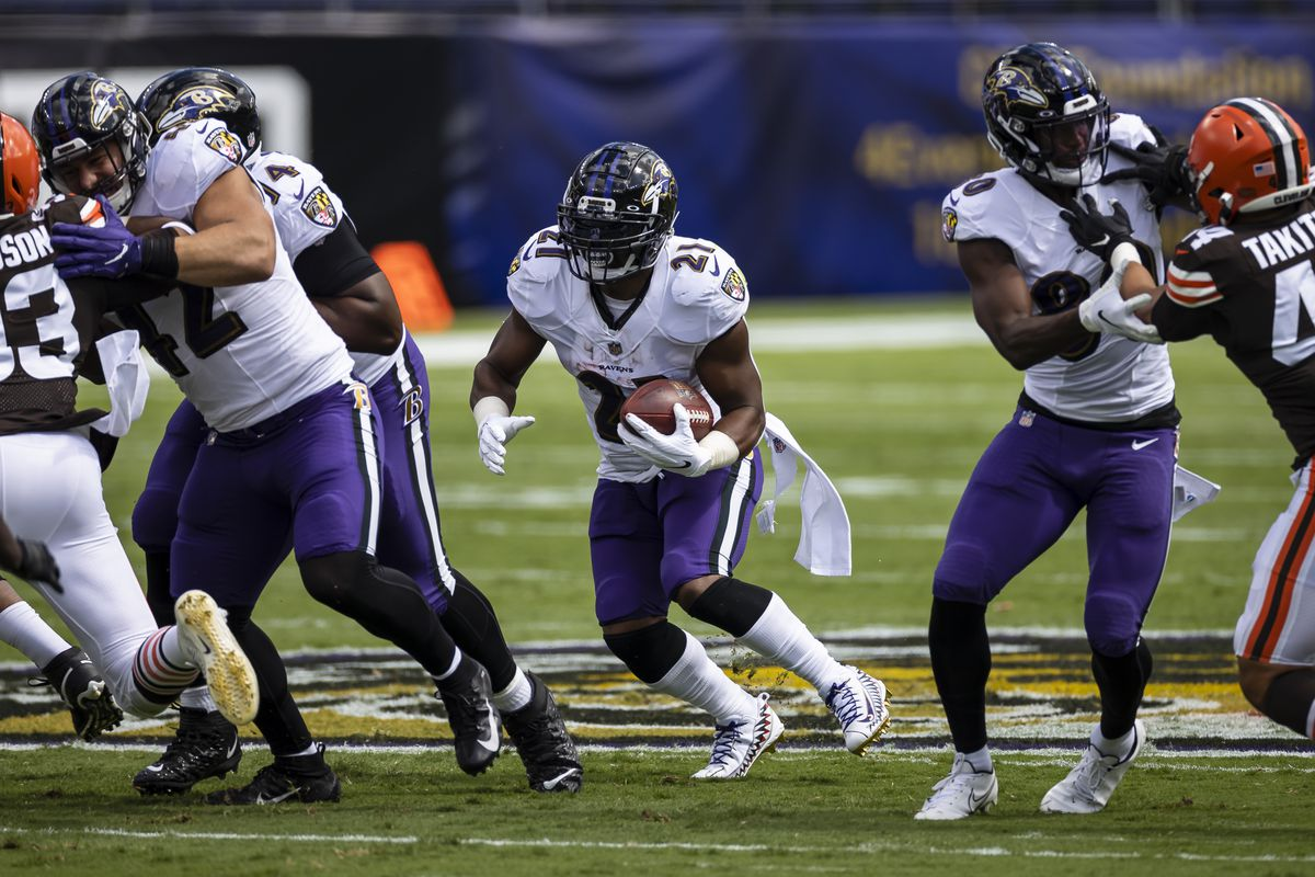 Mark Ingram II #21 of the Baltimore Ravens carries the ball during the first half of the game against the Cleveland Browns at M&T Bank Stadium on September 13, 2020 in Baltimore, Maryland.