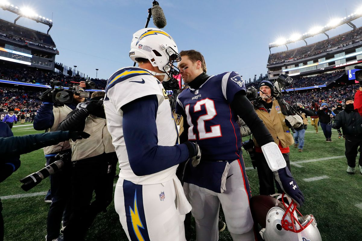 New England Patriots quarterback Tom Brady and Los Angeles Chargers quarterback Philip Rivers meet after an AFC Divisional playoff football game at Gillette Stadium.