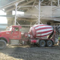 Concrete truck pouring in right center field along Sheffield