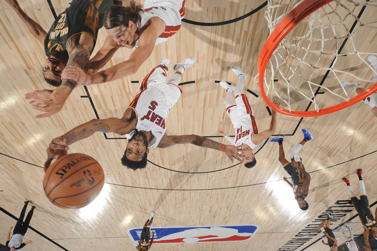 Derrick Jones Jr. of the Miami Heat reaches for the ball during the game against the Oklahoma City Thunder on August 12, 2020 at The Visa Athletic Center at ESPN Wide World Of Sports Complex in Reunion, Florida.