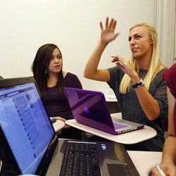 Mariah Lohse, second from right, expresses an opinion during class. Law professor Randy Dryer has created an honors course that explores issues of transparency and privacy in our lives and in government. The class is also transparent in that students' papers are posted on a class website, classes are video recorded, and students are required to Tweet and blog their thoughts. Thursday, Oct. 20, 2011.