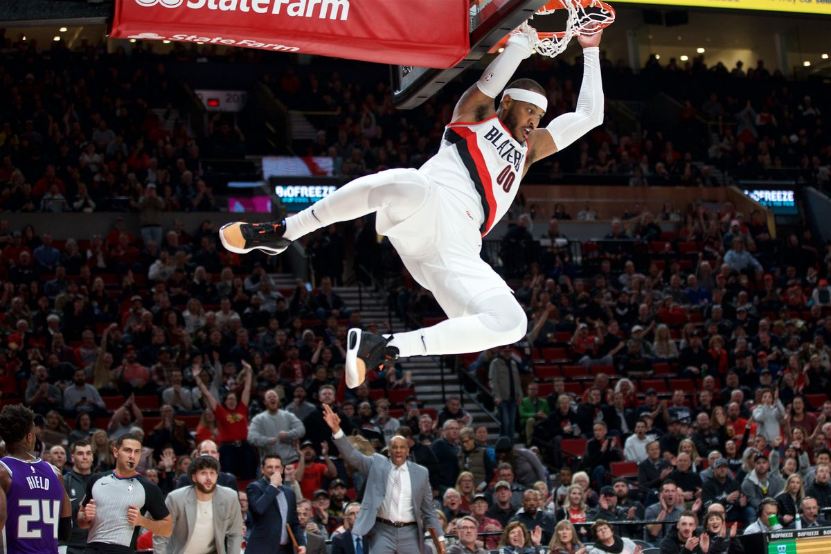 Portland Trail Blazers forward Carmelo Anthony dunks against the Sacramento Kings during the first quarter at the Moda Center.
