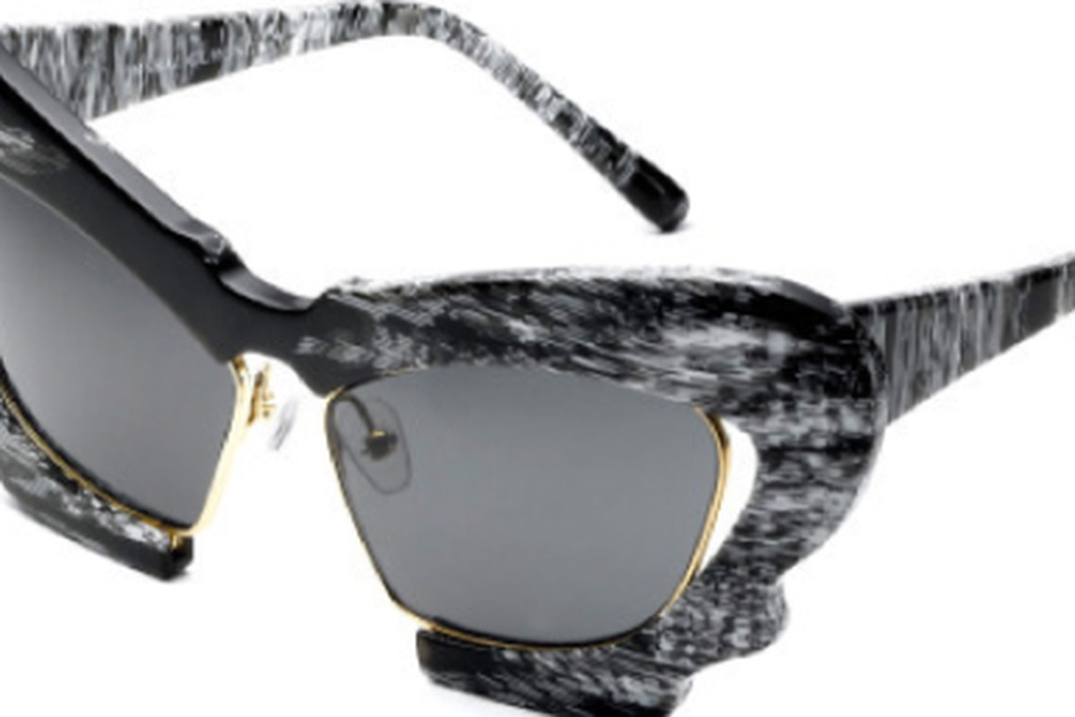 "Prabal Gurung for Linda Farrow Projects, <a href=""http://shop.modaoperandi.com/catalog/shop-my-style-taylor-tomasi-hill-fall-2012/looks/#linda-farrow-black-and-white-horn-sunglasses"">$462</a>."