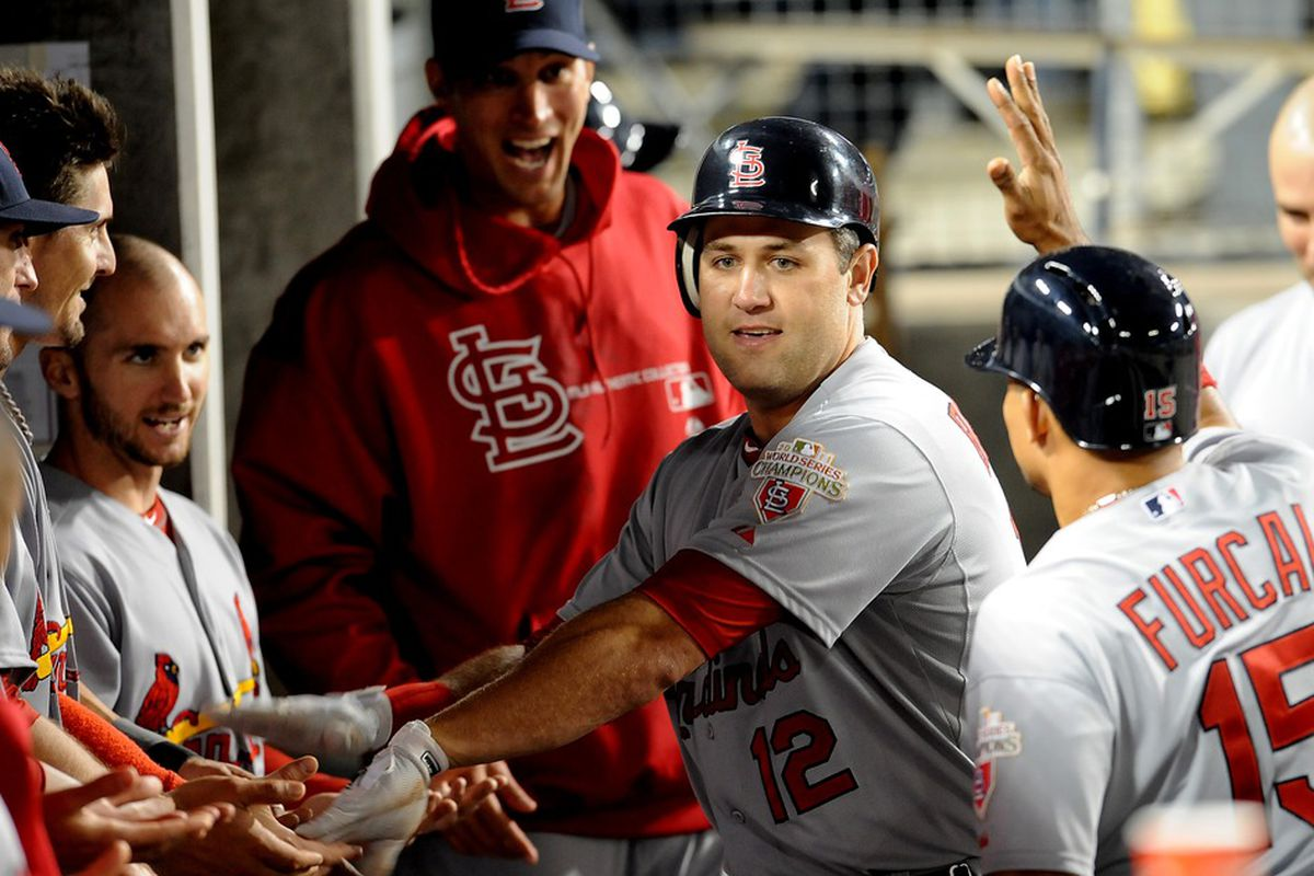 May 18, 2012; Los Angeles, CA, USA;  St. Louis Cardinals first baseman Lance Berkman (12) enters the dugout after a solo home run in the 9th inning against the Los Angeles Dodgers at Dodger Stadium. Mandatory Credit: Jayne Kamin-Oncea-US PRESSWIRE