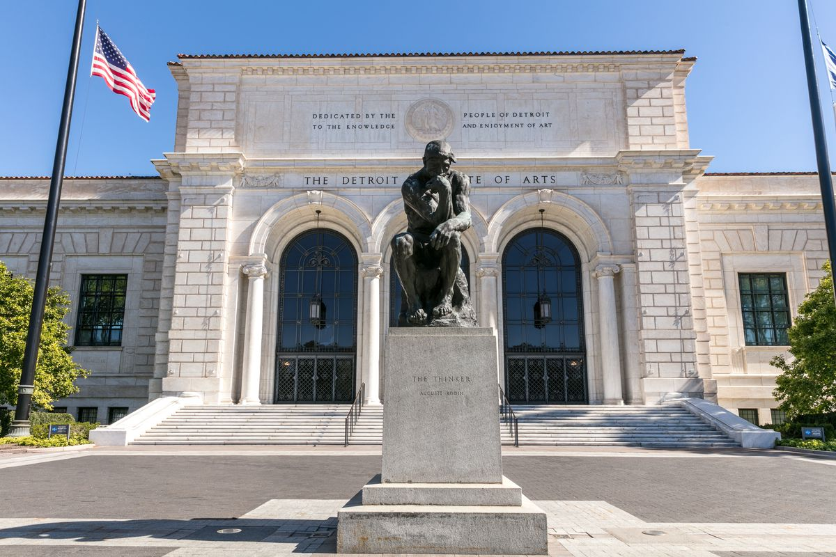 """A statue of """"The Thinker"""" is shown directly in front of the entrance to the DIA."""