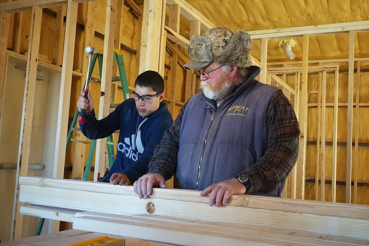 Ray Perez, a sophomore at Custer County High School, works with instructor Bruce May on a project that will convert a former preschool building into teacher housing.