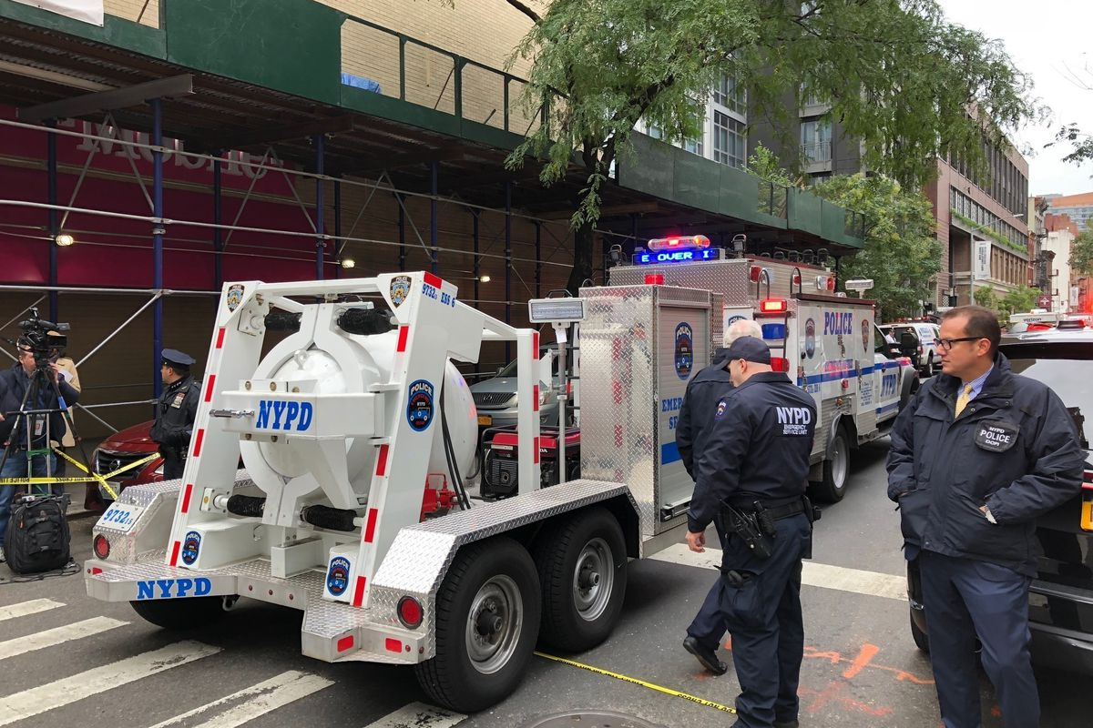 NYPD's Total Containment vessel arrives as law enforcement respond to the scene of a suspicious package at a postal facility, Friday, Oct. 26, 2018 in New York. Two law enforcement officials say a package closely resembling parcels sent to critics of Pres