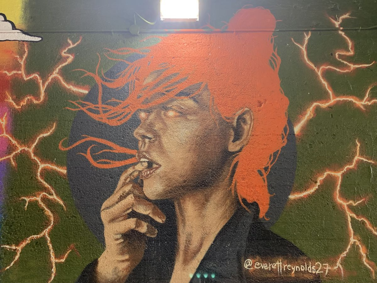 """Chicago artist Everett Reynolds says this mural was """"originally designed to simply be a beautiful lady."""" He made a late addition, putting the lightning bolts in the background, """"to symbolize the beautiful energy felt while the viaduct was being painted."""""""