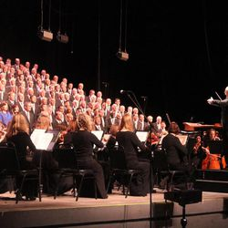 Music director Mack Willberg leads the Mormon Tabernacle Choir and Orchestra at Temple Square during their concert June 27, 2015, at Bethel Woods Center for the Arts in New York.