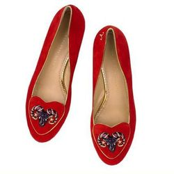 """Charlotte Olympia 'Aries' shoes, <a href=""""http://us.charlotteolympia.com/collections/BIRTHDAYSHOESARIES-SPCOSMIC.html?dwvar_BIRTHDAYSHOESARIES-SPCOSMIC_color=SUEDE_600_RED#cgid=WESTERN+COSMIC&start=1"""">$695</a>"""