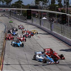 Josef Newgarden (67) attempts a pass on Dario Franchitti (10), of Scotland, heading into the first turn at the start of the IndyCar Series' Long Beach Grand Prix auto race, Sunday, April 15, 2012, in Long Beach, Calif. Newgarden hit a tire barrier, and was out of the race.