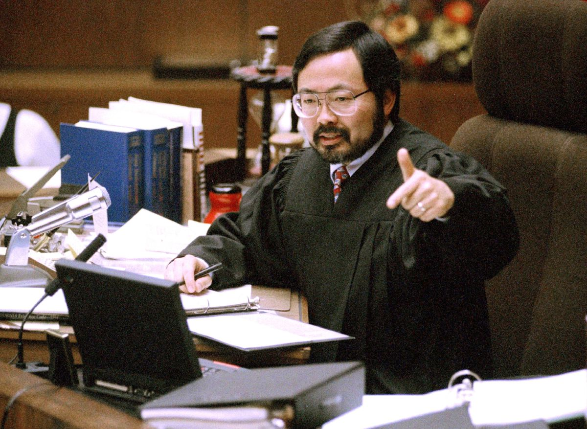 FILE - In this Feb. 12, 1995, file photo, Judge Lance Ito gives instructions to the jury before all parties in the O.J. Simpson double murder trial depart on a tour of four prominent Brentwood sites in Los Angeles. Ito, who retired in 2015, presided over