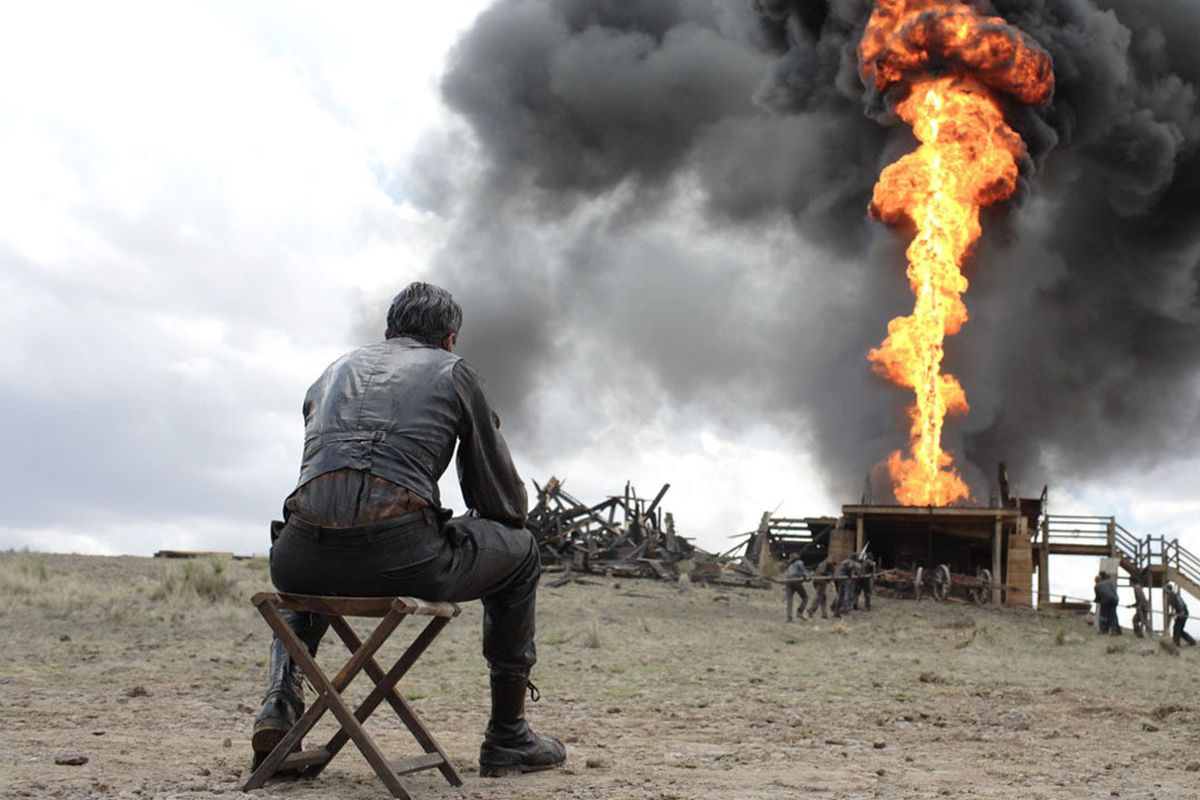 Still of a man watching an explosion in 'No Country for Old Men'