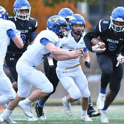Phillips' Jahleel Billings (9) pulls away from the defense. Worsom Robinson/For the Sun-Times.