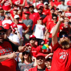 Utah fans celebrate their victory against Washington State uring an NCAA college football game at Rice-Eccles Stadium on Saturday, Sept. 25, 2021 in Salt Lake City. Utah won the game 24-13.