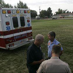 Weber County emergency crews investigate the scene where a powered parachute hit Hooper Tomato Days celebrants.