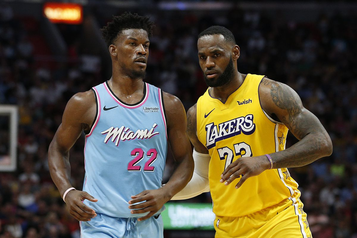 LeBron James of the Los Angeles Lakers guards Jimmy Butler of the Miami Heat during the second half at American Airlines Arena on December 13, 2019 in Miami, Florida.