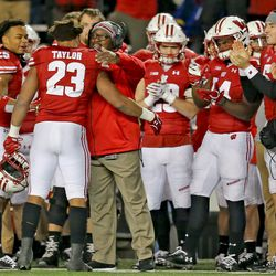 Jonathan Taylor is greeted by his teammates and coaches. It is perhaps the last time #23 will play at Camp Randall, having established the three year NCAA rushing record.