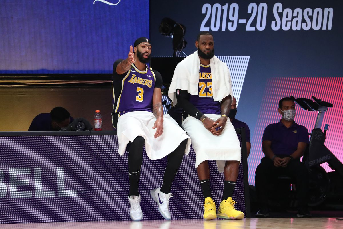 Anthony Davis talks with LeBron James of the Los Angeles Lakers during Game Five of the Western Conference Finals of the NBA Playoffs on September 26, 2020 at AdventHealth Arena in Orlando, Florida.
