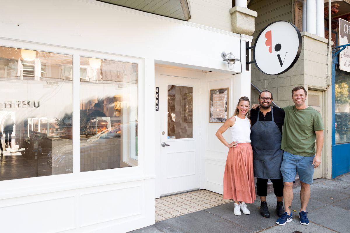 Owners Priscilla Dosiou and Thomas Glenwright and chef Esteban Beas outside Village Rotisserie
