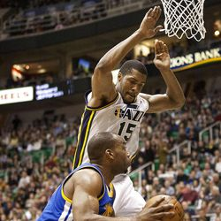 Jazz forward Derrick Favors (15) goes up to block a Warriors shot during the second half of the NBA basketball game between the Utah Jazz and the Golden State Warriors at Energy Solutions Arena, Wednesday, Dec. 26, 2012.