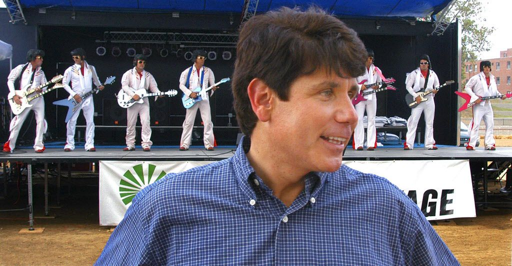 Gov. Rod Blagojevich is shown as the the Flying Elvi perform behind him during Democrats Day at the Illinois State Fair in Springfield, Ill., Wednesday, Aug. 13, 2003. (AP Photo/ Illinois State Fair, David Blanchette)