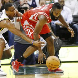 Utah Jazz's point guard Alec Burks (10) tries to knock the ball away from Houston's James Harden as the Jazz and the Rockets play Saturday, Nov. 2, 2013 in EnergySolutions arena. Jazz lost 104-93.
